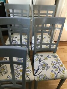 5 blue grey dining chairs with fabric seats.