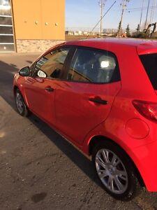 2011 red Mazda 2