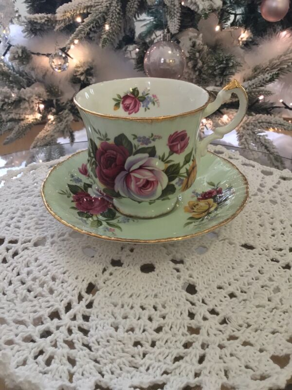 Beautiful Paragon Teacup & Saucer Mint green with a Flower Motiff amazing