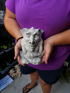 Devil gargoyle concrete statue. $20. Located at Eagleby