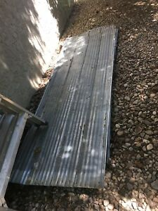 13 sheets of reclaimed galvanized roofing material