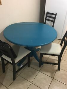 Round blue wooden dinning table with chairs