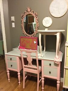 Pink vanity with mirror and chair