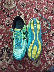 Size 5 Under Armour youth Soccer boots.