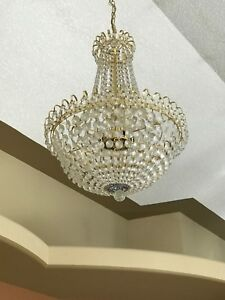 Two Crystal and Brass Chandeliers