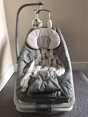 Joie Dreamer grey baby bouncer rocker chair In The Rain with sounds & vibration