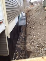 Excavation and Backhoe. Got water problems? Rock busting