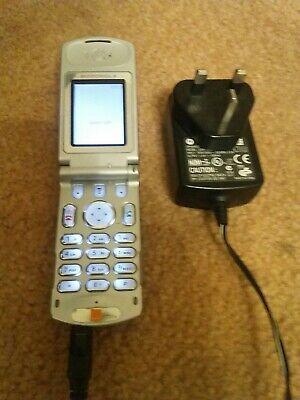 MOTOROLA T720e mobile flip phone with charger on Orange