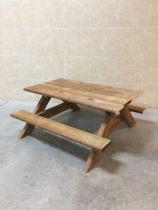 New built brown pressure treated wood kids picnic table
