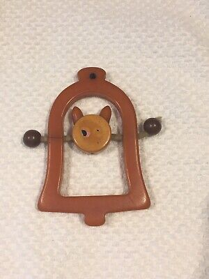 Vintage Butterscotch Bakelite Cat In Bell Baby Crib Toy