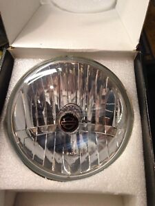 Genuine Harley Davidson headlight.