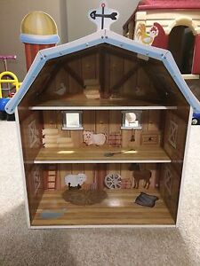 Wooden barn with standing farm animals