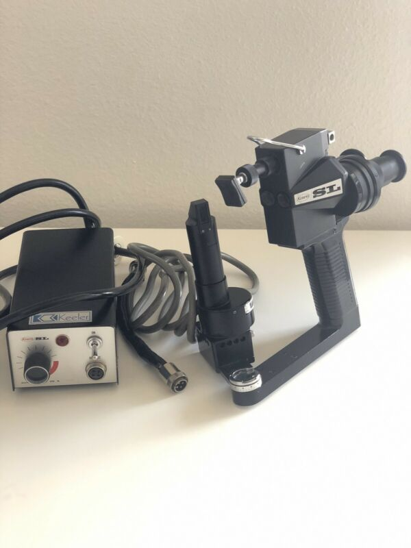 Portable hand held slit lamp