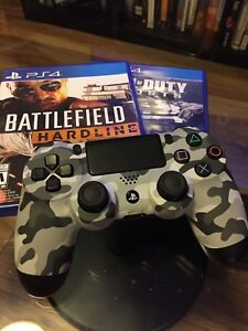 PS4 controller and two games