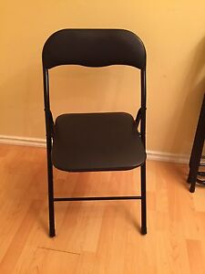 3 black fold up chairs