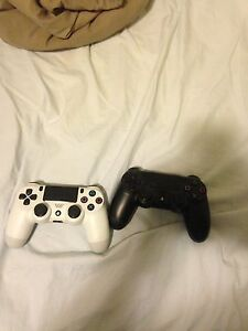 Selling PS4 controllers (white and black)