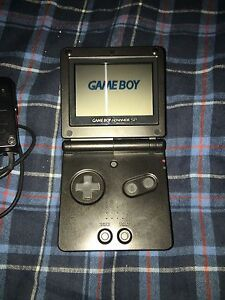 Black Gameboy Advance SP with charger and games