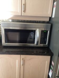 Oven microwave with exhaust fan.
