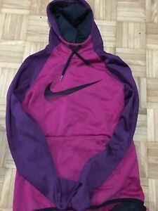 Pink and purple Nike sweater Size: SMALL