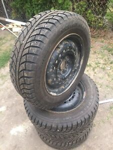 "New studded 14"" tires and rims"
