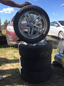 Set of 4 rims and tires for a Kia