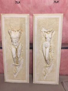 2 stone male and female art pieces