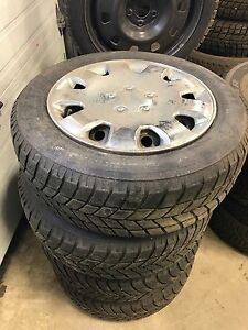 Four used tires and rims with hubcaps