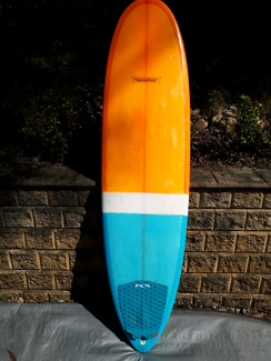 """Lovechild 7'0"""" surfboard with pin tail quad."""