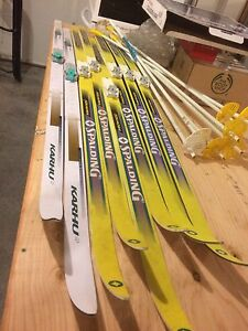 4 Sets of Cross Country Skis, Poles, andBoots