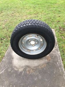 245/70R17 truck winter tires on rims with hub cap