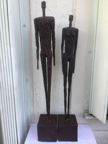 MID CENTURY MODERN GIACOMETTI STYLE ELONGATED METAL PAIR OF SCULPTURES MAN WOMAN