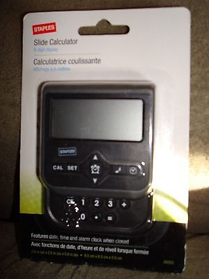 STAPLES SLIDE CALCULATOR WITH DATE TIME AND ALARM CLOCK