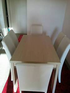 6 seater wood dining table plus 6 white tall soft leather chairs Westmead Parramatta Area Preview