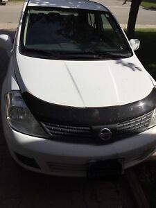 2010 Nissan Versa Standard. Sold as is!