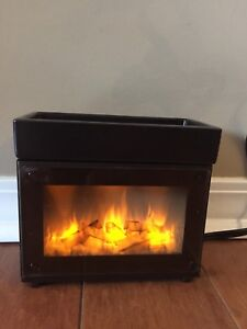 Partylite melts electric fireplace