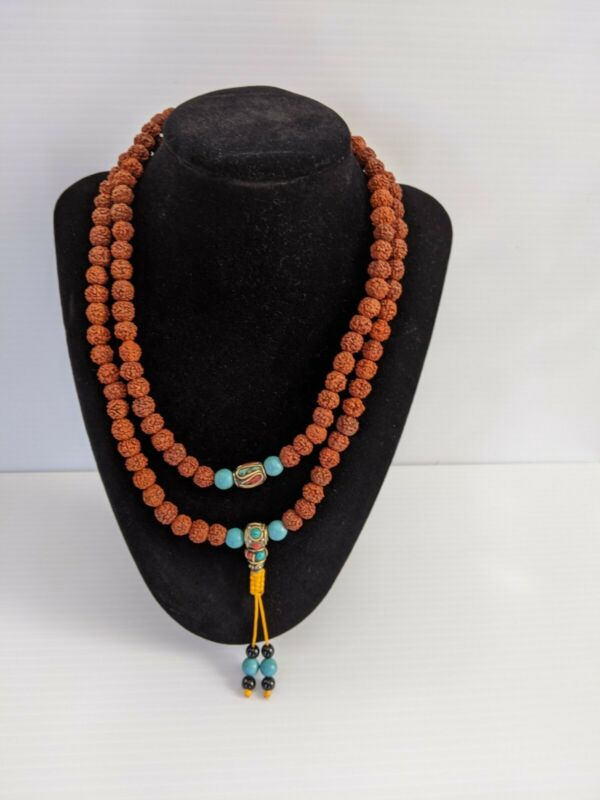 108 rudraksha bead Nepalese Mala bead necklace with blue beads and yellow tas