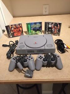 Original PlayStation with games,controllers and cables.