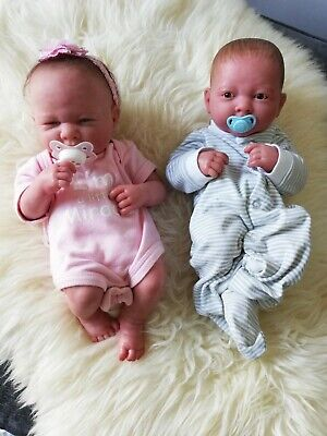 Full Body Soft Vinyl Premature Reborn Twin Dolls ( Girl and Boy ) with clothes.