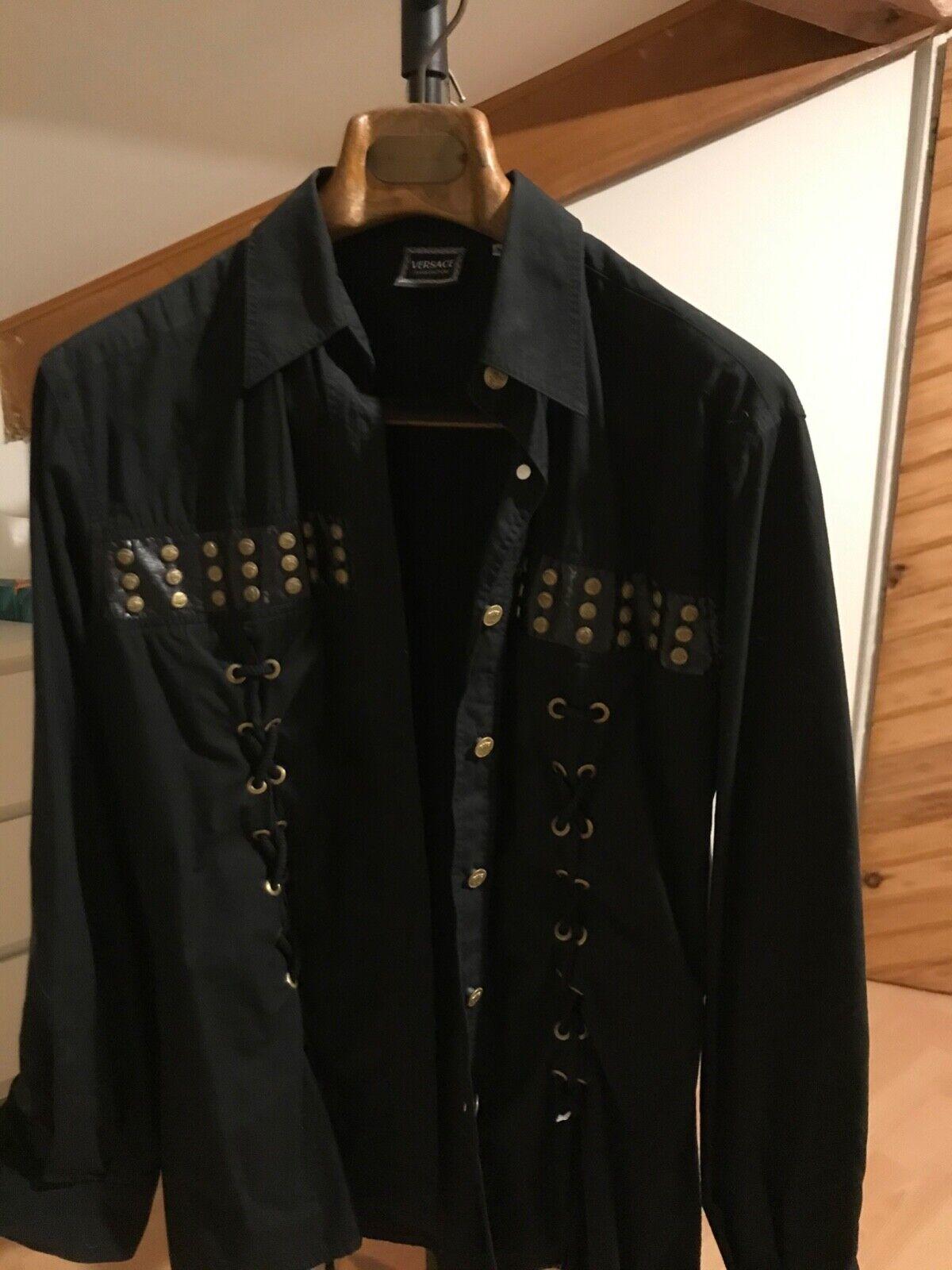 Chemise femme noire  taille m manche longue versace jeans couture clous/laçage