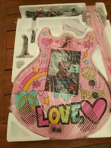 Pink cd/bluetooth guitar other items