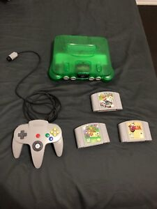 Nintendo 64 green with games