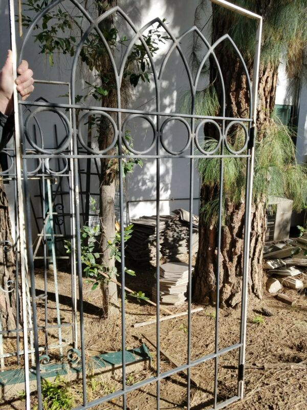 Antique wrought iron arched gate or window guard