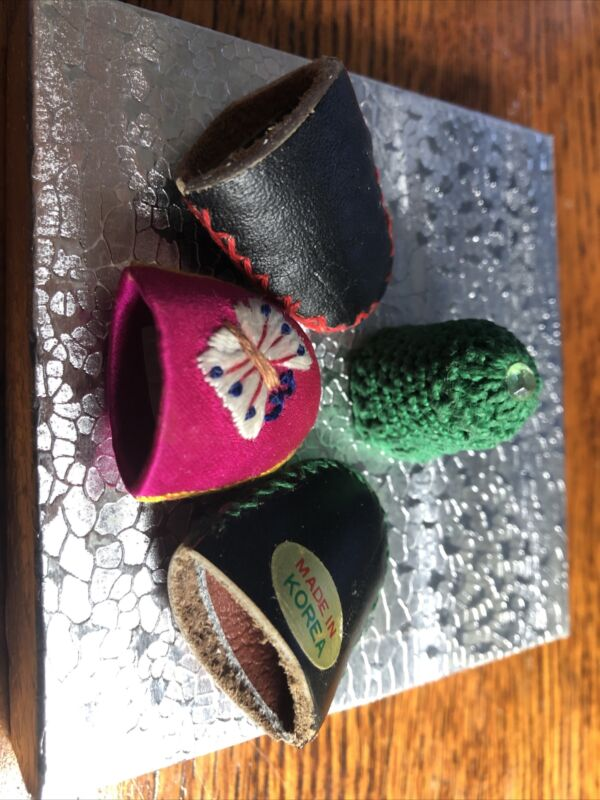 Thimbles  3 leather made in Korea and 1 green Crochet