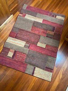 Modern rug - red / orange / brown
