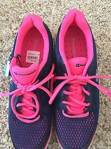 Brand new size 10 woman's Champion Sneakers