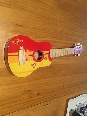 Hape Kid's Wooden Toy Ukulele in Red And Yellow Hape Music Note Pattern