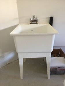 Brand new laundry sink with faucet