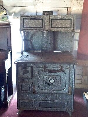 ANTIQUE HOME COMFORT WOOD COOK STOVE