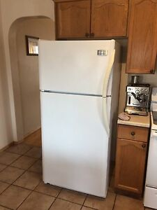 Frigidaire 18cf fridge and Frigidaire range pair.