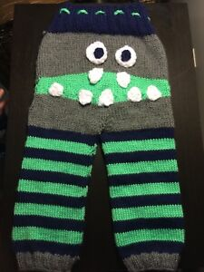 Brand new knitted monster pants and matching hat.